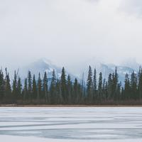 Tree Line in the horizon across the Frozen lake in Banff National Park, Alberta, Canada