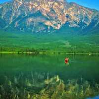 Canoeing in a emerald green lake in the Canadian Rockies