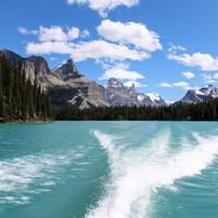 Mountain and lake landscape behind the boat in Jasper National Park, Alberta, Canada