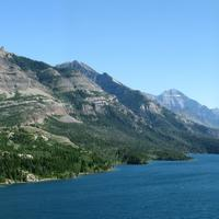 Mountains, shoreline, and lake landscape in Waterton lakes national park panorama