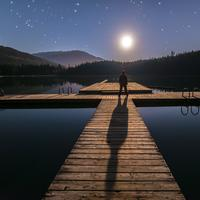 Standing on the docks looking at the moon and stars in British Columbia