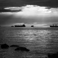 Light on the ocean with ships in Vancouver, British Columbia, Canada