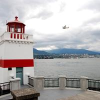 Lighthouse with plane flying in Vancouver Port in British Columbia, Canada