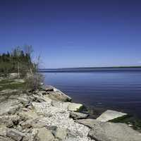 Rocky Shoreline of Lake Winnipeg with clear sky at Hecla Provincial Park