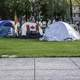 People protest camping on the lawn downtown in Winnipeg