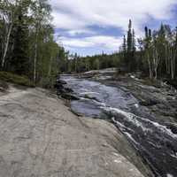 Cascading Water of the Cameron River landscape on the Ingraham Trail