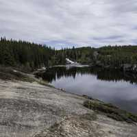 Landscape of the Cameron River with the waterfall in the distance on the Ingraham Trail