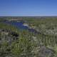 Long Blue lake in the middle of Pine Forest on the Ingraham Trail