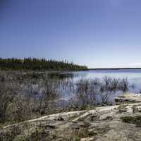 Overlooking the lake landscape under blue skies on the Ingraham Trail