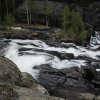 Time-Lapse of cascading water splashing down rocks at Cameron Falls, Ingraham Trail