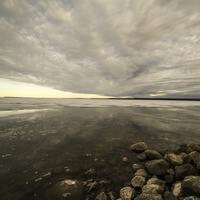 Lakeshore Landscape under Cloudy Dramatic Skies at dusk on Great Slave Lake