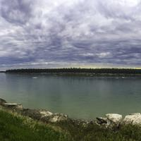 Panoramic of the Mackenzie river landscape under clouds