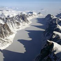 Ice covered fjord on Baffin Island with Davis Strait in the back in Nanuvut, Canada