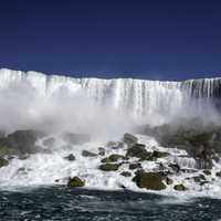 Frontal View of American Falls from river in Niagara Falls, Ontario, Canada