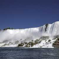 Side view of American falls from the River at Niagara Falls, Ontario, Canada