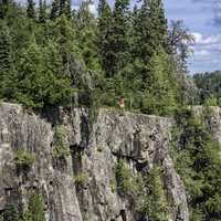 Man standing on the bluff at Ouimet Canyon Provincial Park, Ontario