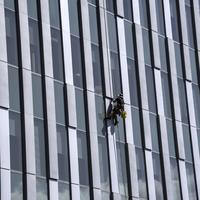 Window Washer on tower in Thunder Bay, Ontario, Canada