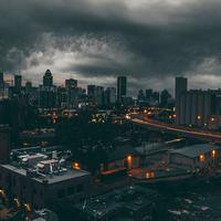 Black Clouds over the Night Time Cityscape of Montreal, Quebec, Canada