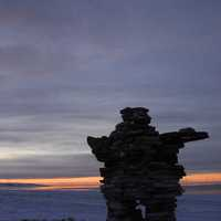 Inuksuk in the Tundra Landscape in Quebec, Canada