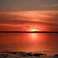 Red Sunset over the Seas in Quebec, Canada