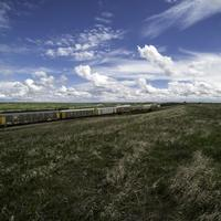 Train and landscape under the Beautiful Skies in Saskachewan