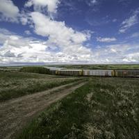 Train under the clouds and sky in Saskatchewan