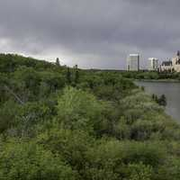Dark Skies over the trees and skyline of Sasktoon