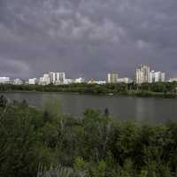 Full Skyline of Saskatoon under the clouds and skies