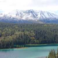 Majestic Landscape with lake, Mountains, and Forest in Yukon Territory, Canada