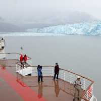People looking at Hubbard Glacier in the Yukon