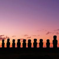 Moai Statues at Dusk in the landscape on Easter Island, Chile