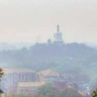 White Pagoda in the pollution in Beijing, China