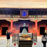 Worshipping at Lama Temple in Beijing, China