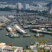 Boats and buildings with cityscape in Sanya