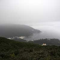 Mountainside foggy landscape with sea