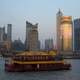 Skyline of Pudong, Shanghai, China behind a boat