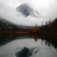 Mountain and Reflection with clouds and Mist in the water in Sichuan, China