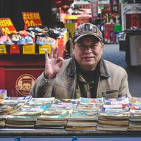 Man selling Books in the marketplace in Tianjin, China