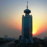 Tower in front of the setting sun in Tianjin, China