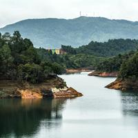 Landscape with river and forest in Guatape, Colombia