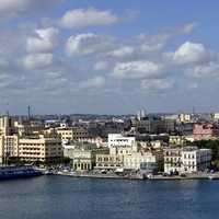 Skyline and cityscape under sky and clouds in Havana, Cuba