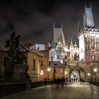 Charles Bridge and night city in Prague, Czech Republic