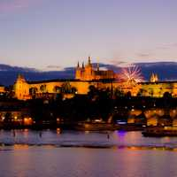 Dusk over Prague with lights and Fireworks