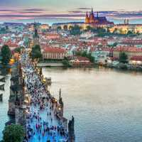 People on the bridge with cityscape in Prague, Czech Republic