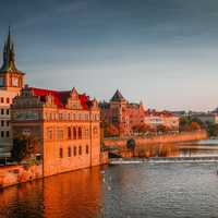 Sunset view of the river and shoreline buildings in Prague, Czech Republic
