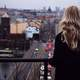 Woman overlooking the city of Prague, Czech Republic