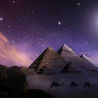 Pyramids with bright moon and stars