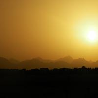 Sun over the desert landscape in Egypt