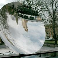 Nottingham Playhouse and Roman Catholic Cathedral reflected in Anish Kapoor's Sky Mirror in England