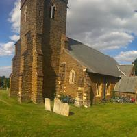 Church next to tombstones and lots of bikes